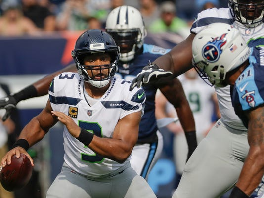 titans score 21 straight points in 3rd beat seahawks 33 27
