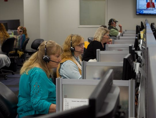 Customer care employees at work in JTV's call center.