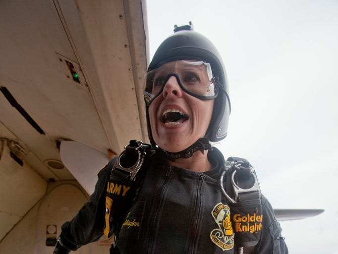 SGT Sherri Gallagher, from Arizona, and a member of the Golden Knights, is the first to jump as part of the Thunder Over Utah air show Saturday, July 26, 2014.