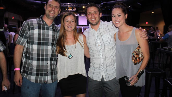 Justin Crowell, Meagan Crowell, Brandon Crowell and Michelle Mackay pose for a group photo at the High Heels & Hopes Fashion Show at Cargo in the Whitney Peak Hotel on Aug. 9.