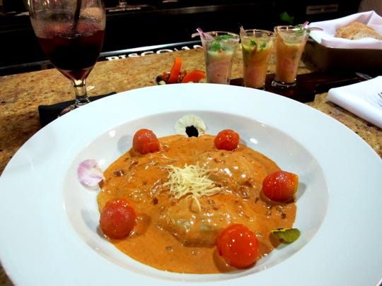 Shrimp ravioli with sun-dried red chili cream sauce and confit sherry tomatoes at Lima Restaurant and Pisco Bar in Golden Gate.