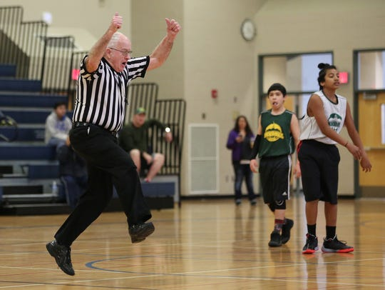 Millard Bates, 86, jumps while officiating a Skyball