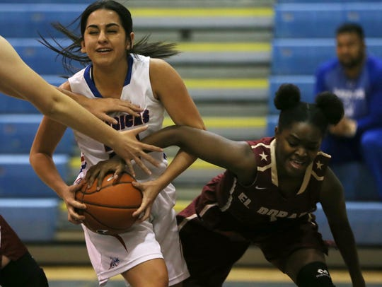 Americas' Amaya Holguin fought off a steal attempt