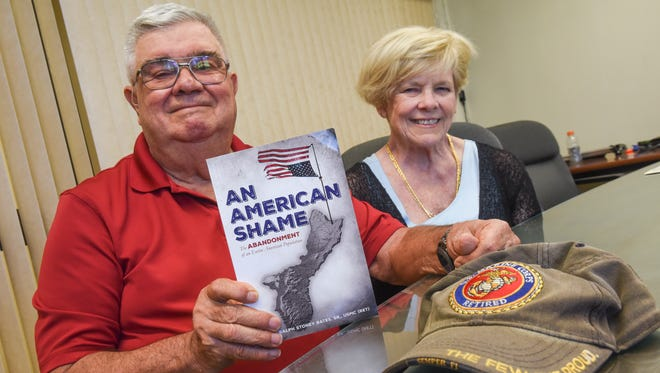 Author and retired U.S. Marine Corps Maj. Ralph Stoney Bates Sr. displays a copy of his book, An American Shame, as he is photographed with his wife and researcher, Lyn Bates, in Hagåtña on Friday, Dec. 9, 2016. The book, described by Ralph Bates, documents the heroism of the Chamorro people who were left to be under the rule of Japanese Imperial Forces during World War II. The book also includes a listing of the Chamorros killed during the invasion, occupation and liberation of Guam.