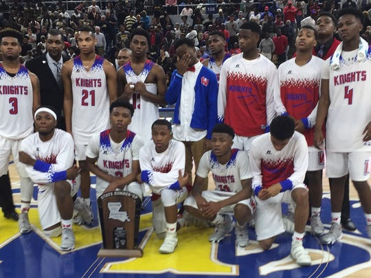 The Woodlawn basketball team finished as state runners-up in the LHSAA Class 4A championships.