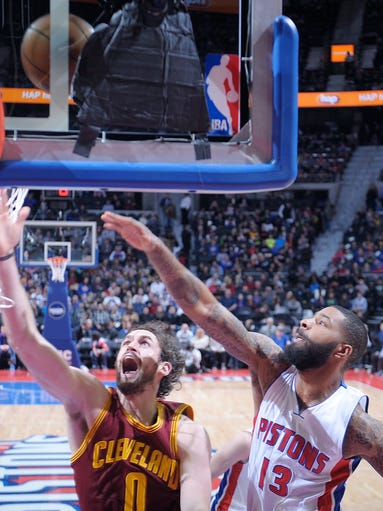 The Cleveland Cavaliers' Kevin Love scores over the