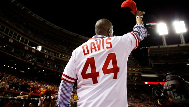 Former Reds outfielder Eric Davis recognizes the crowd during a postgame celebration of the 1990 World Series-winning team on April 24 at Great American Ball Park.
