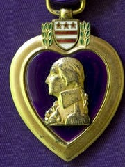 Logan Kidwell's Purple Heart medal was awarded posthumously.