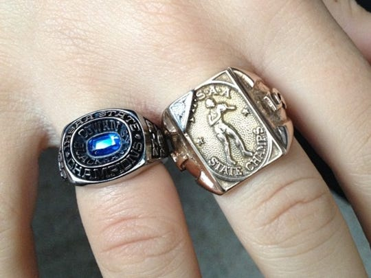 Kellsie Mace's 2012 volleyball state championship ring, left, next to her grandpa's 1951 basketball state ring.
