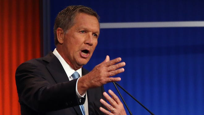 Republican presidential candidate Ohio Gov. John Kasich speaks during the first Republican presidential debate at the Quicken Loans Arena Thursday, Aug. 6, 2015, in Cleveland.