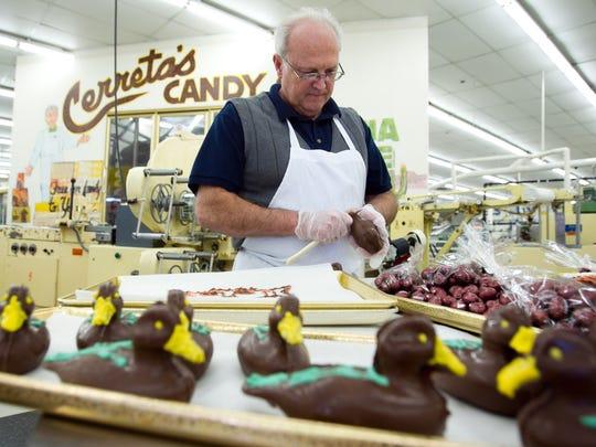 Joe Cerreta makes chocolate ducks for Oregon fans at Cerreta Candy Company in Glendale.