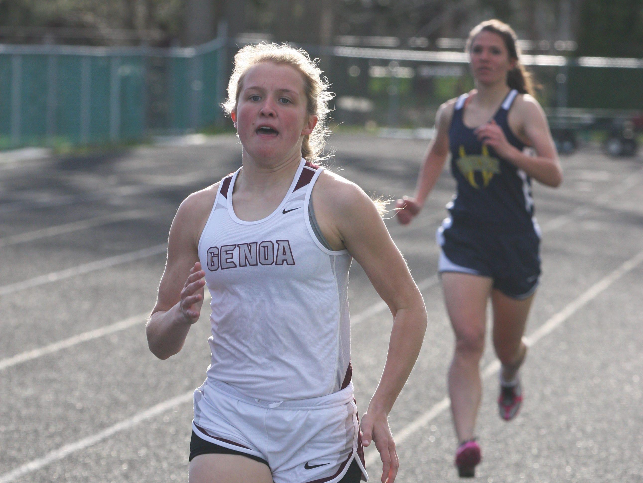 Genoa's Carly Gose pulls away from Woodmore's Jessie Wegert to win the 200 meter run.