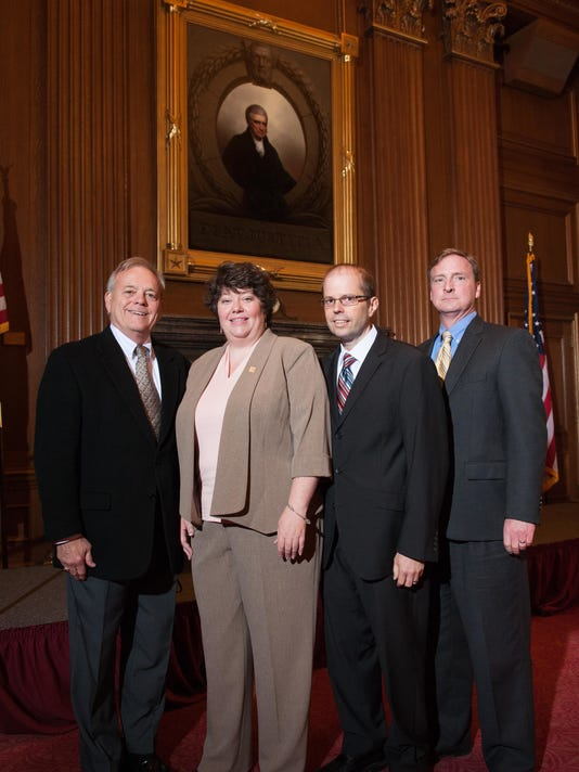 York County Court of Common Pleas Deputy Administrator Jennifer Reider inside the U.S. Supreme Court at her graduation with, from left to right, President Judge Stephen P. Linebaugh, Clerk of Courts Don O'Shell and Court Administrator Paul Crouse.