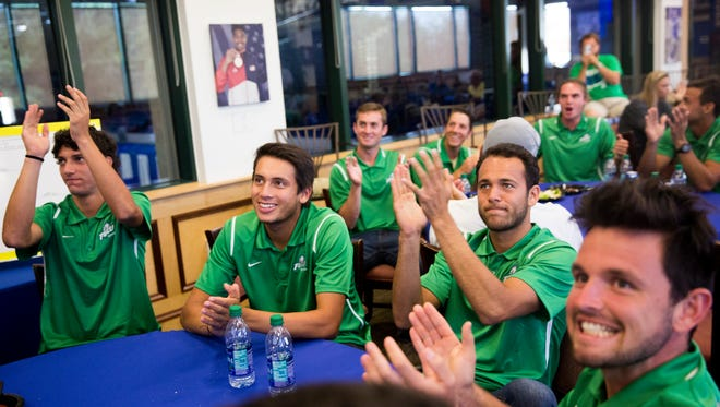 The FGCU men's tennis team reacts immediately after hearing they will play the University of Florida in the first-round of the men's tennis NCAA Tournament Tuesday, May 2, 2017 in Fort Myers, Fla. FGCU will face Florida in the first-round.