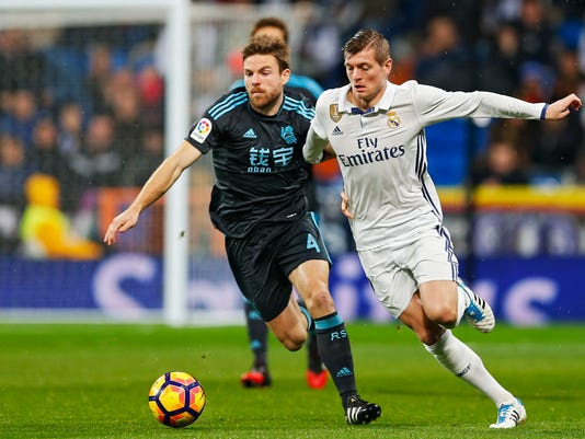 FILE - In this Sunday, Jan. 29, 2017 file photo, Real Sociedad's Asier Illarramendi, left, and Real Madrid's Toni Kroos fight for the ball during a Spanish La Liga soccer match at the Santiago Bernabeu Stadium in Madrid. Illarramendi, not long ago considered a flop at Real Madrid, has boyhood club Real Sociedad sitting near the top of the Spanish league. Illarramendi's unstoppable long-distance strike sealed Sociedad's 2-1 win at Espanyol on Friday, Feb. 10, a victory that lifted the Basque Country club past Atletico Madrid and into fourth place. (AP Photo/Francisco Seco, File)