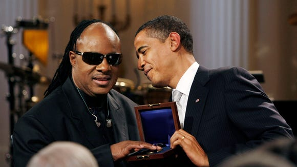 President Obama presents Stevie Wonder with the Library