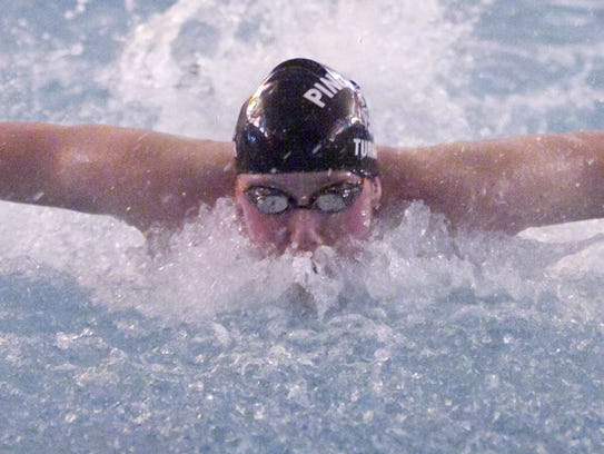 Pinckney's David Turner swims butterfly in the third