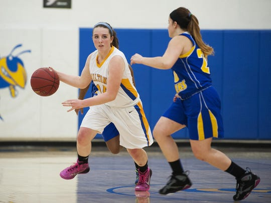 Milton's Kate Rowley (14) dribbles the ball down the court during a high school girls basketball game last season.