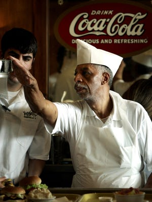 Longtime Vandyland employee Mack McGee checks orders as he prepares food for customers during the restaurant's last day in 2006.