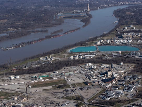 A view of chemical plants in the Rubbertown area of Louisville with the swollen Ohio River in the background. Feb. 26, 2018.
