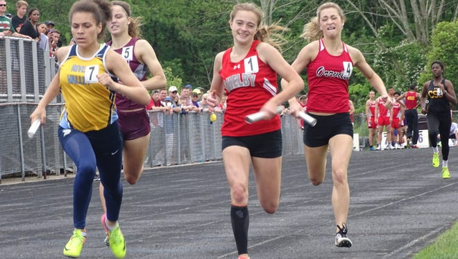 River Valley's Tatyana Young, left, edges Shelby's Regan Clary by less than a tenth of a second to anchor the Vikings to a Division II regional championship in the 4x400 relay last year at Lexington. Young is back as a junior this season.