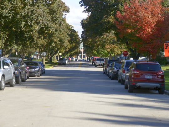 Cars parked along Blue Ridge Drive in Ashwaubenon, looking toward Lambeau Field on Sunday, Oct. 9, before the Packers-Giants game.