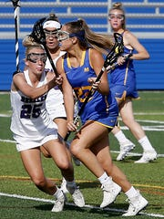 Mariemont middie Courtney Robinson is challenged by