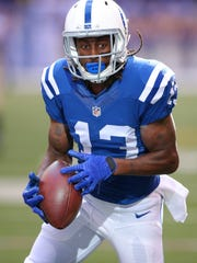 Indianapolis Colts wide receiver T.Y. Hilton (13) hangs on to the ball for a completed pass reception to score during the second half of an NFL football game Sunday, Oct. 25, 2015, at Lucas Oil Stadium.
