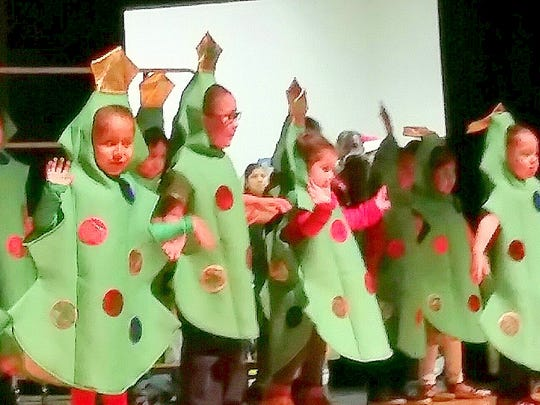 "Young dancers perform ""The Dancing Tree"" song during the Mescalero Apache Elementary  Christmas program."