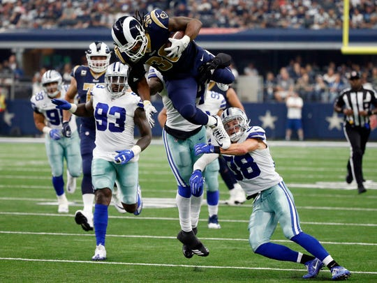 Los Angeles Rams running back Todd Gurley (30) is stopped