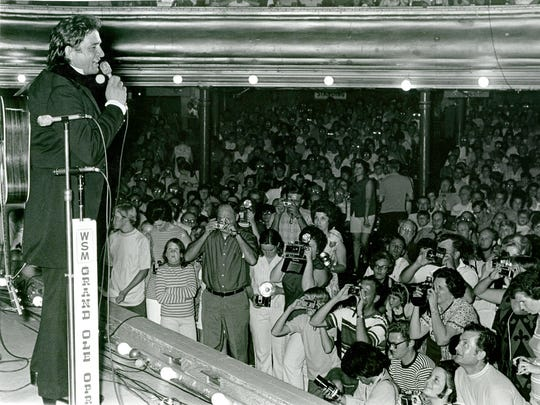 Les Leverett's photo of Johnny Cash performing at the Ryman Auditorium in 1971.