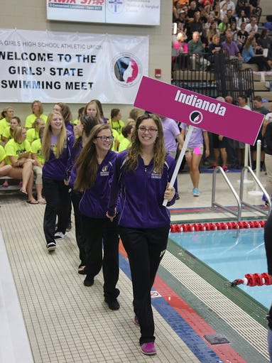 The Indianola swim team makes their entrance during
