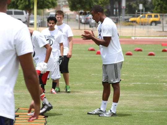 "At far right, James Dockery, a National Football League player holds his first annual ""James Dockery Football Camp"" at Palm Desert High School on."