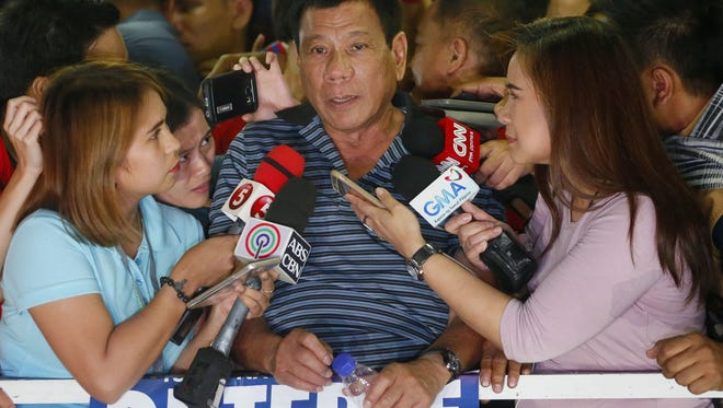 Front-running presidential candidate Mayor Rodrigo Duterte talks to the media during a campaign event at Silang township, Cavite province, south of Manila, Philippines, April 22.