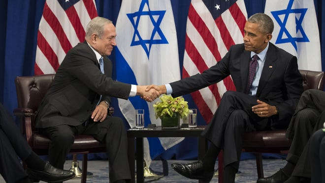 """Prime Minister of Israel Benjamin Netanyahu shakes hands with President Obama during a bilateral meeting at the Lotte New York Palace Hotel Wednesday. Last week, Israel and the United States agreed to a $38 billion, 10-year aid package for Israel. Obama is expected to discuss the need for a """"two-state solution"""" for the Israeli-Palestinian conflict."""