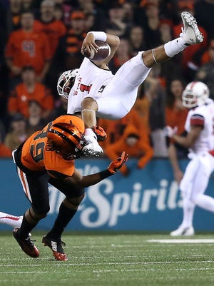 Beavers Justin Strong tackles Utah quarterback Kendal Thompson during their game with the Utes on Thursday Oct. 16, 2014, in Corvallis.