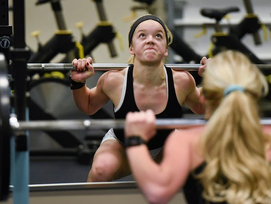 Sofie Streich, 15, lifts weight during her workout