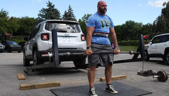 Battle Creek's Ben Yarger dead lifts a 450-pound car during the Michigan Strongman Amateur State Championships on August 6 in Frankenmuth.