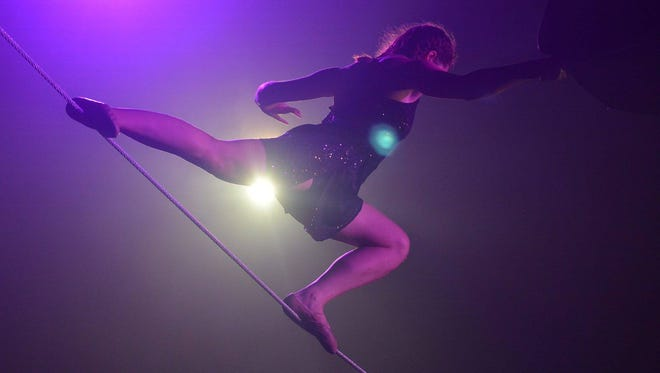 Baltimore's In the Dark Circus Arts will put on a blacklight aerial performance as part of Saturday's gala at The Delaware Contemporary.