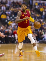 Indiana Pacers forward Paul George (13) races the ball