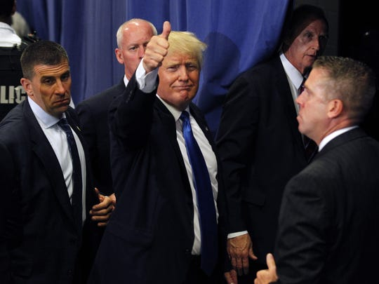 Donald Trump waves to the crowd after a campaign rally in Cincinnati on July 6, 2016.