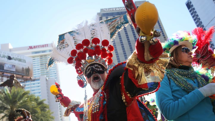 Foot marchers with the Krewe of Zulu walk through New Orleans, La. on Feb. 9, 2016. Fat Tuesday, or Mardi Gras in French, is a celebration traditionally held before the observance of Ash Wednesday.