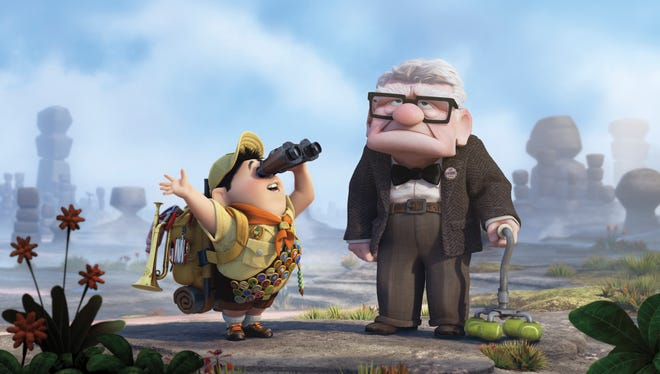 """Animated characters Russell, left, and Carl Fredricksen are shown in a scene from the film, """"Up,"""" showing on BBC America."""