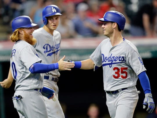 Cody Bellinger, right, Justin Turner, left, and Corey Seager, back, are part of a dynamic and powerful lineup for the Dodgers. Turner, however, will start the season on the DL after breaking his wrist in a spring training game.