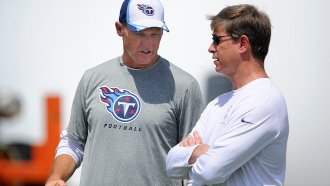 Titans coach Ken Whisenhunt talks with general manager Ruston Webster during practice at Saint Thomas Sports Park on June 18, 2014.