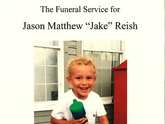 """Photograph of the program from the funeral service for Jason Matthew """"Jake"""" Reish on Oct. 5, 2012."""