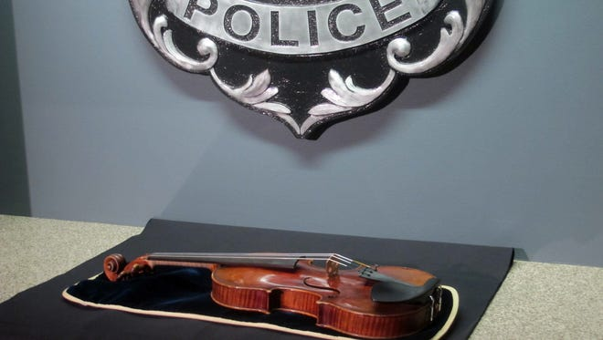 A $5 million Stradivarius violin is displayed at the Milwaukee Police Department Thursday, Feb. 6, 2014, in Milwaukee, a day after police recovered the instrument stolen on Jan. 27 from a concertmaster in a parking lot by a person wielding a stun gun. Police say the violin appears to be in good condition, and a Milwaukee County prosecutor said he planned to charge at least one suspect with felony robbery.