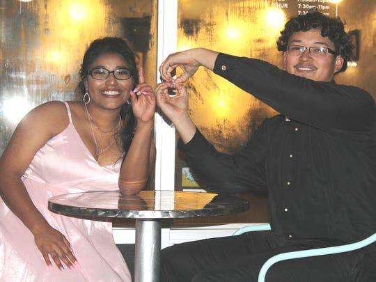 Seniors Jordan Gonzalez and Elyana Galvan celebrate at the Abilene High School Winter Formal.