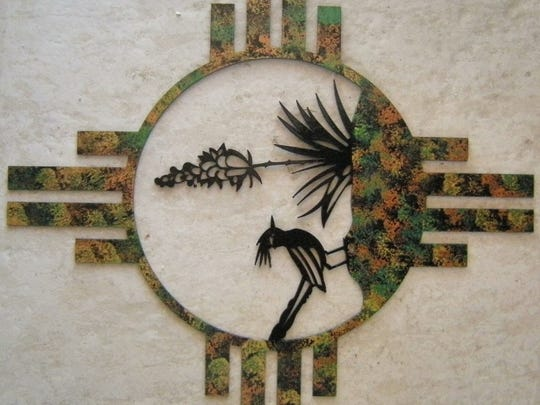 Santiago Santanova's art ofter features motifs from southwestern plants, animals and cultures.