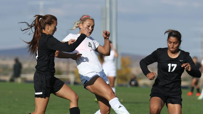 Farmington's Arin Coleman, center, scores a goal against Roswell on Nov. 3 at the Bernalillo Soccer Complex.